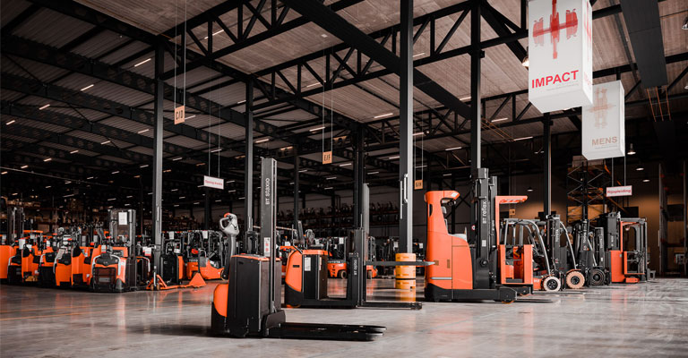 Used trucks in warehouse storage